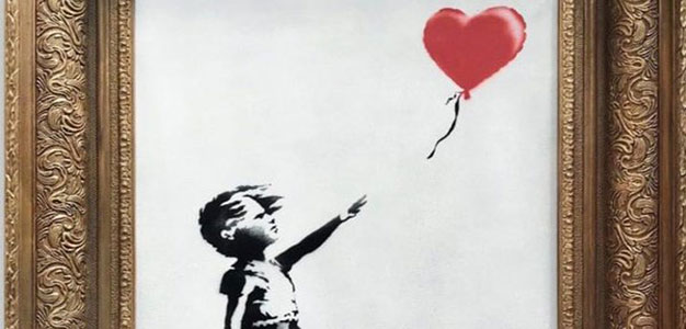 Banksy Painting Self-Destructs Seconds After Being Sold for $1.4 Million at Auction…