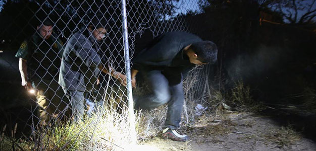 Immigrants Breaking Through Fence at U.S. Border