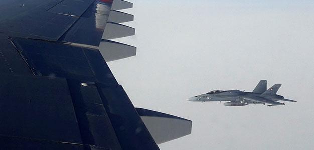 russia_passenger_plane_shadowedby_swiss_jets