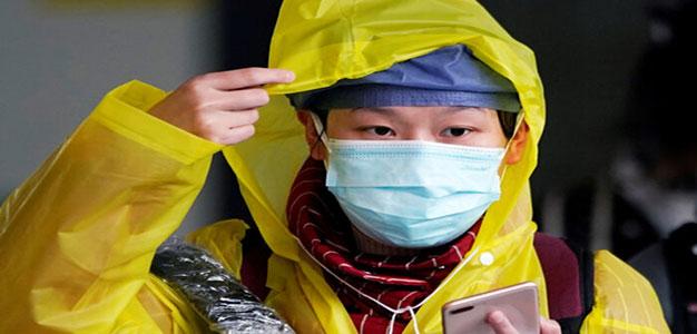 coronavirus_raincoat_yellow_Reuters_Aly_Song