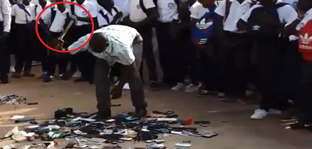 A School Security Guard in Gabon Hammers to Pieces Students Cellphones…